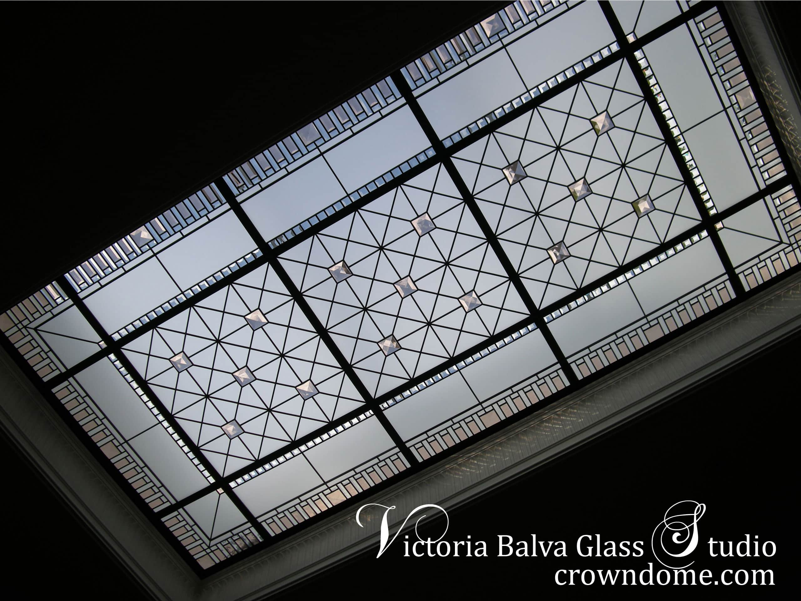 Beautiful geometrical stained leaded bevelled glass ceiling skylight design for luxury double-height grand entrance foyer of custom built luxury house in Toronto. Clear textured glasses, coloured beveled glass. large squared jewels, minimalistic design. Entryway decor ideas