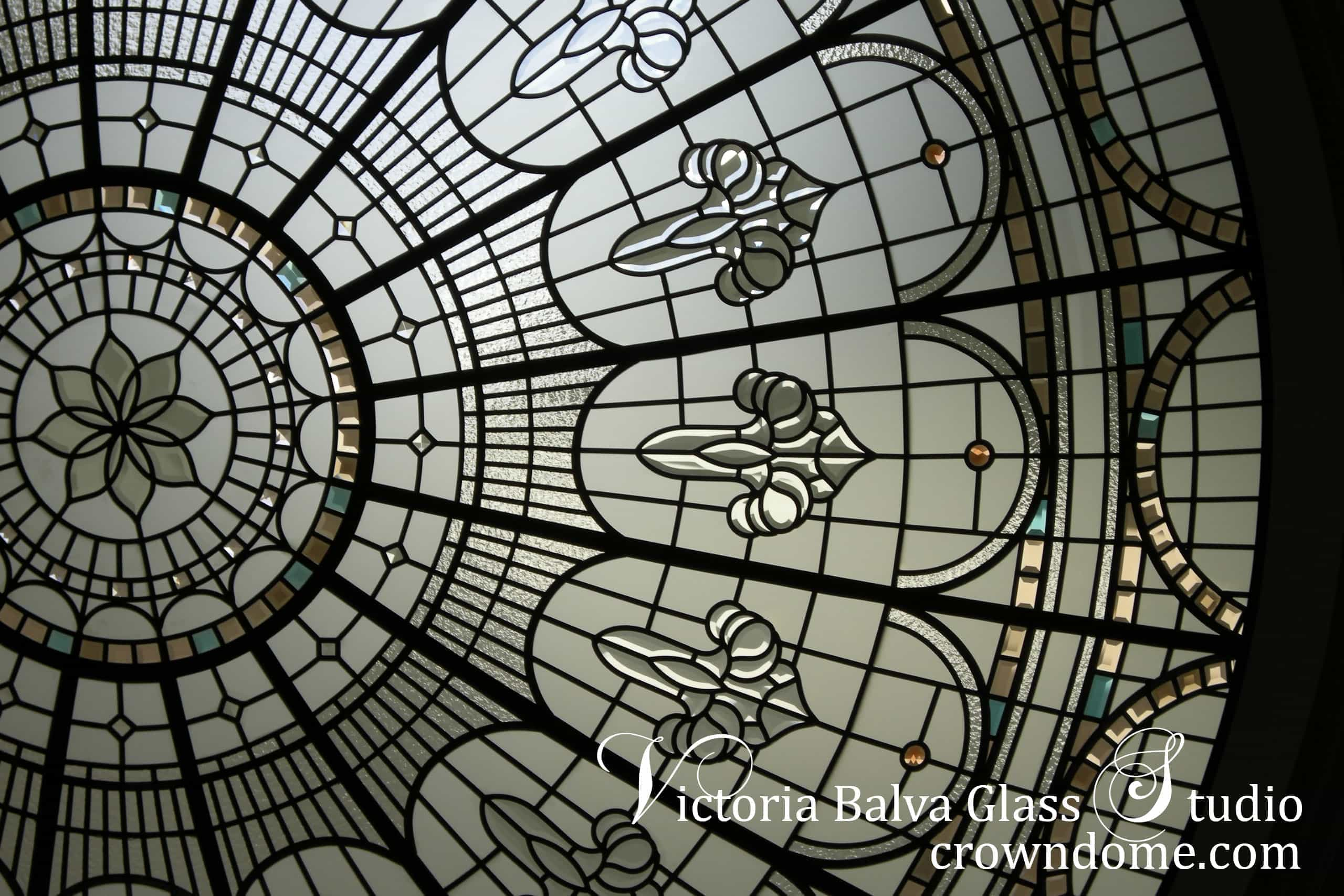 Stained and leaded glass dome with colored jewels, clear acid and beveled glass