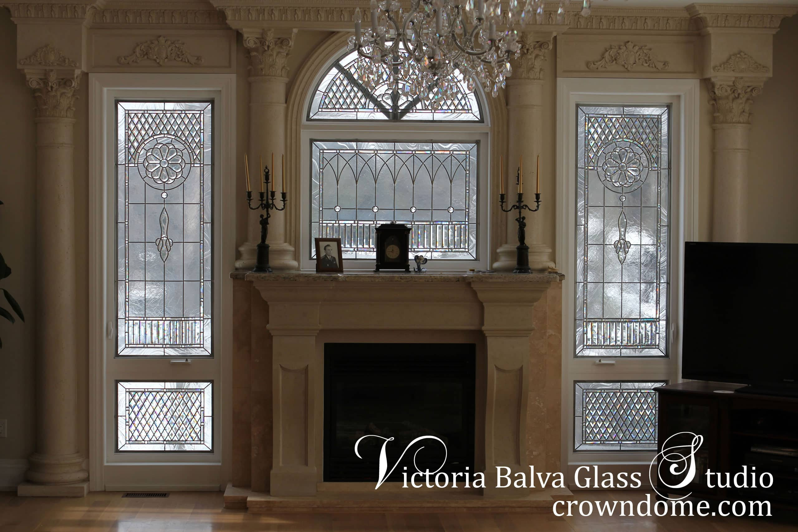 Classic stained leaded beveled glass windows in clear textured glass, beveled glass and crystal jewels for luxury custom built residence in King City. Stained glass window panels are inspired by historical stained glass design. Stained leaded glass windows designed by stained leaded glass artist Victoria Balva