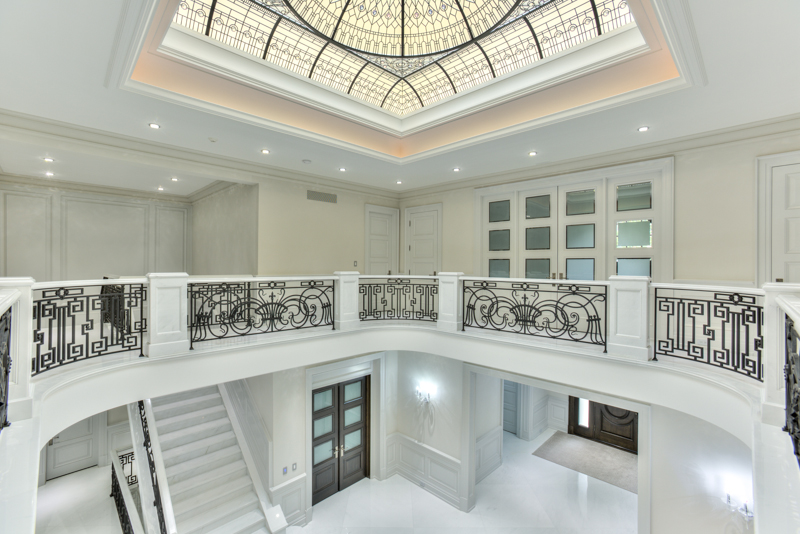 Large leaded glass dome ceiling The Bridle Path for a grand entrance foyer of luxurious custom built residence in Toronto. White marble interior design