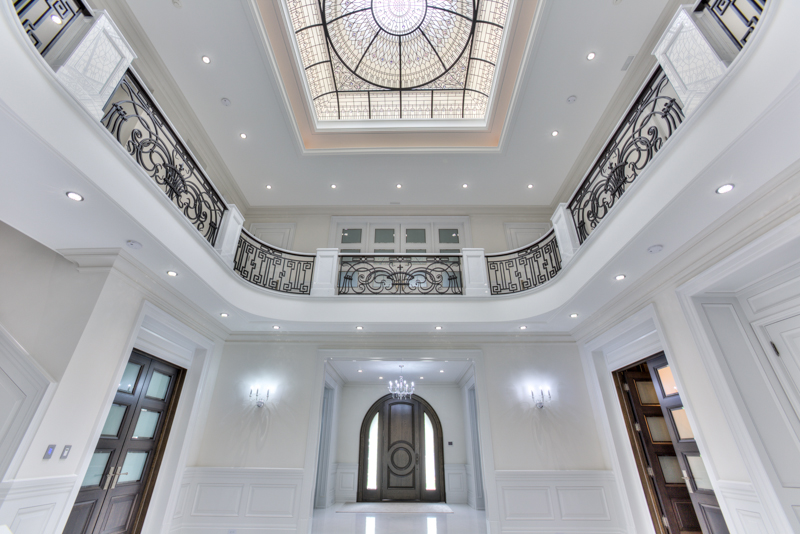 Large leaded glass dome ceiling The Bridle Path for a reception hall foyer of luxurious custom built residence in Toronto. Original glass dome design by glass artist Victoria Balva. Interior design white marble