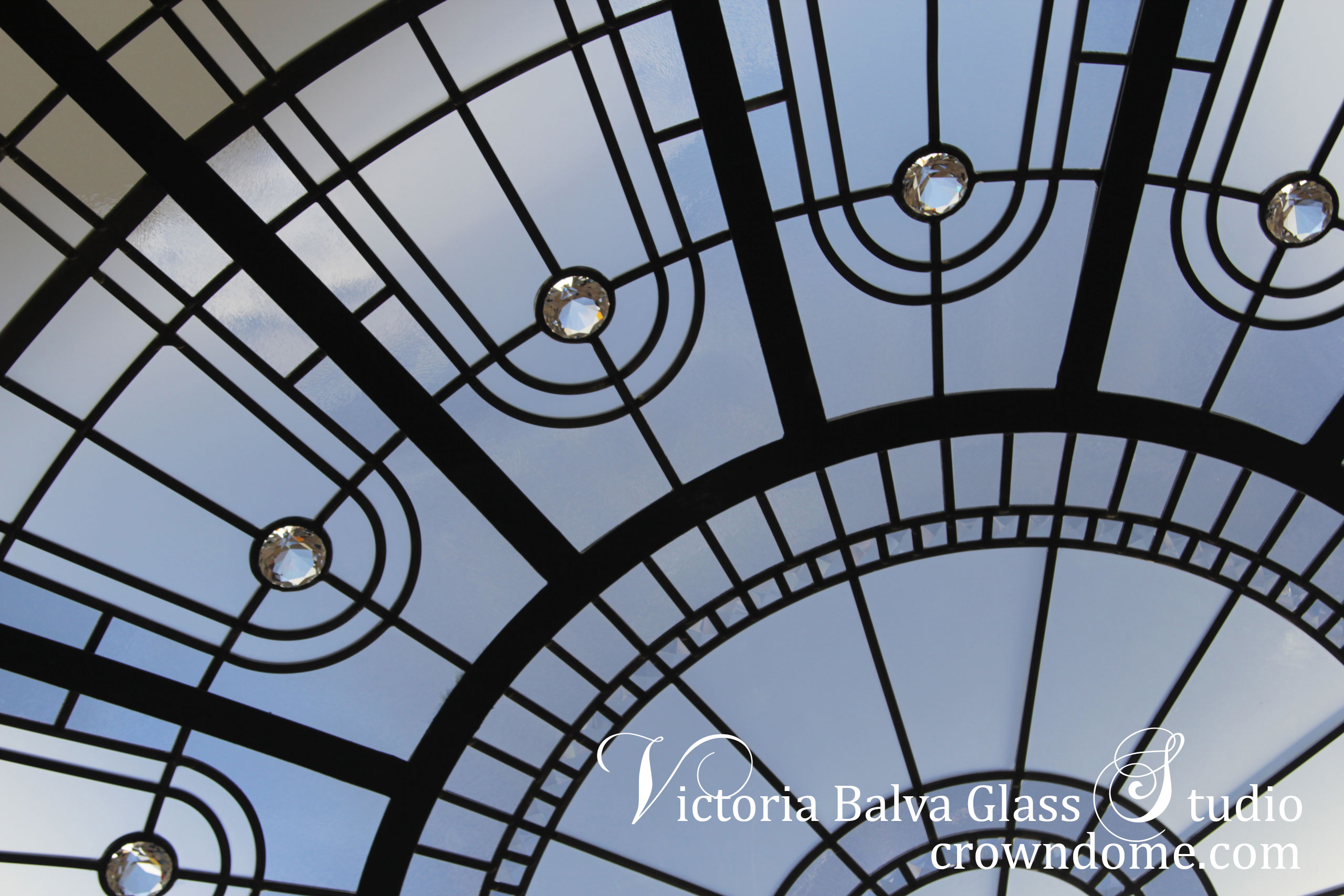 Large stained leaded glass dome skylight ceiling detail for a custom built residence in Toronto. Leaded glass dome skylight with clear textured glass and crystal accent jewels let's natural light in adding style and beauty to the interior space of the house. Large stained leaded glass dome ceiling in minimal contemporary design for a modern house