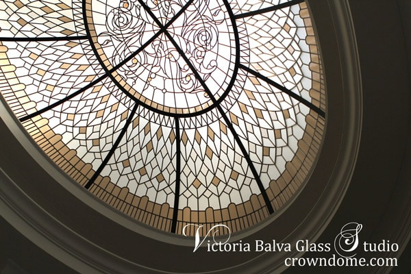 Oval stained leaded glass dome with bronze glass border for a luxury custom built house in Toronto