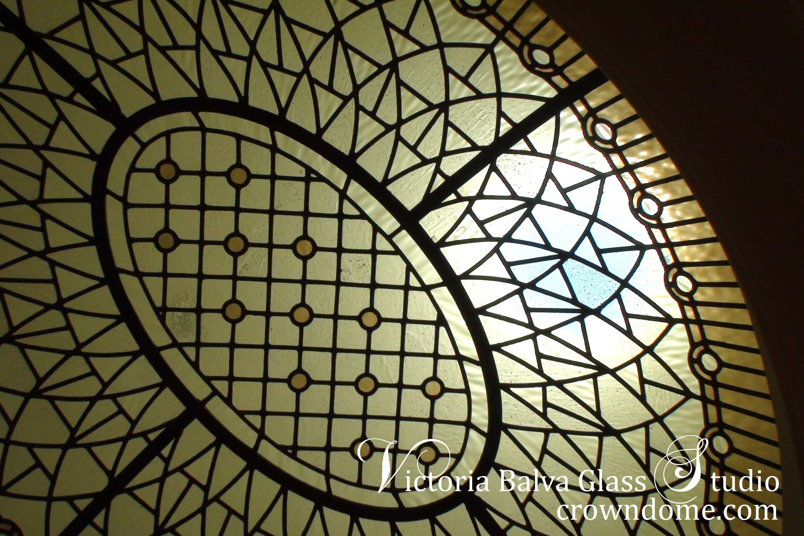 Small stained leaded glass oval dome skylight ceiling for a hallway of a private residence in Toronto. Simple geometric design, antique glass selection, very pale color highlights