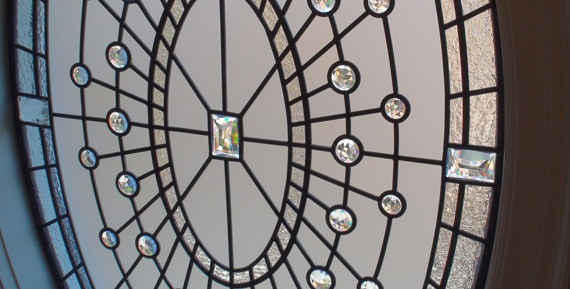 Monochromatic leaded glass oval window Pia's Secret