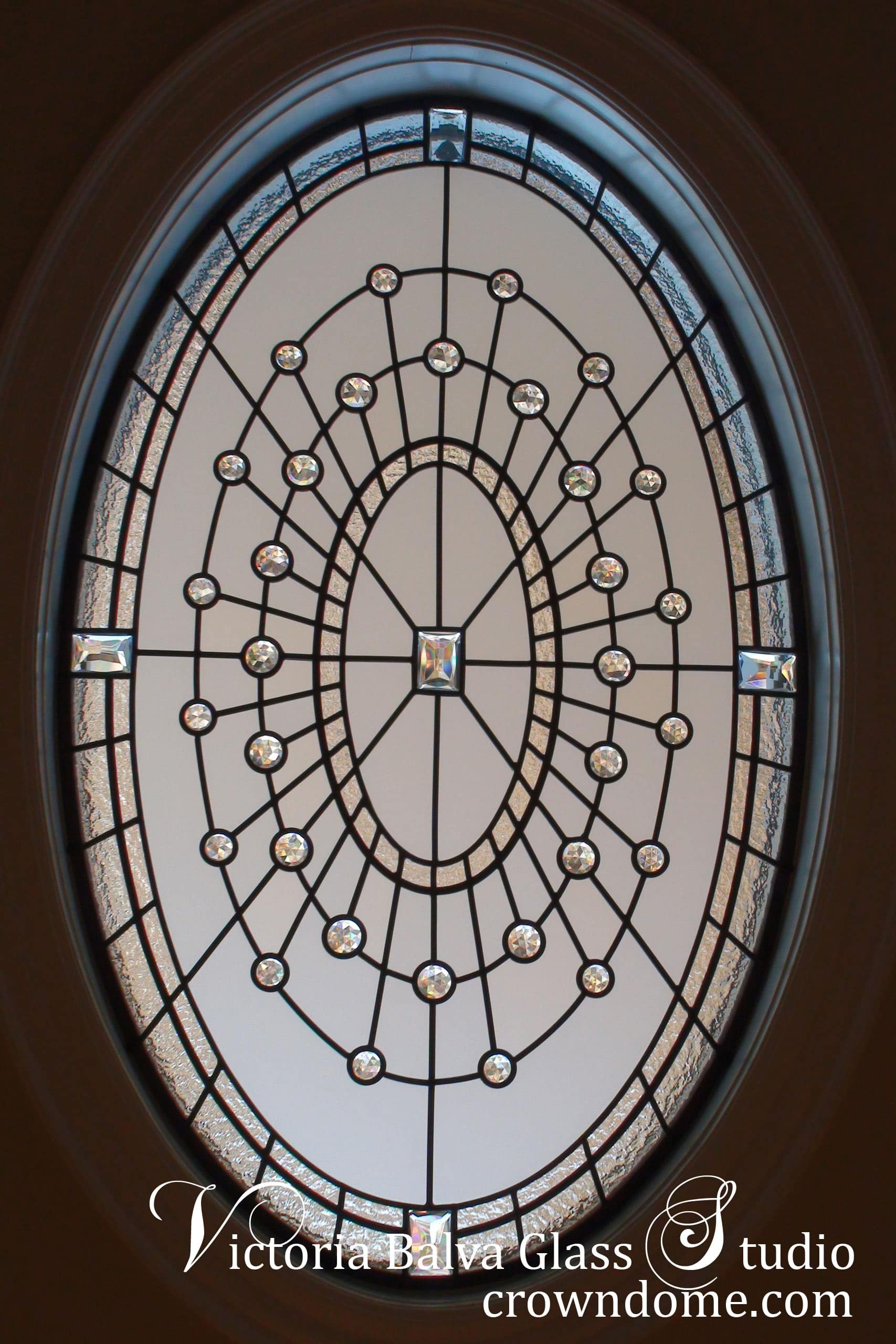 Large leaded glass oval window for a walk-in closet of a custom built residence to add privacy and style. Leaded glass window design combines classic styling and new materials to add personality and soul to the leaded glass window project. Glass design by glass artist Victoria Balva