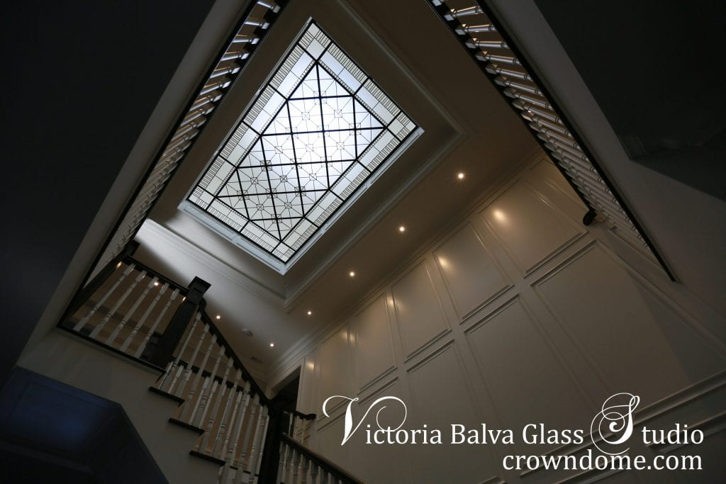 Leaded glass skylight ceiling with clear beveled glass for staircase foyer of a custom built house in traditional style. Clear textured glass, beveled glass, intricate line-work geometry