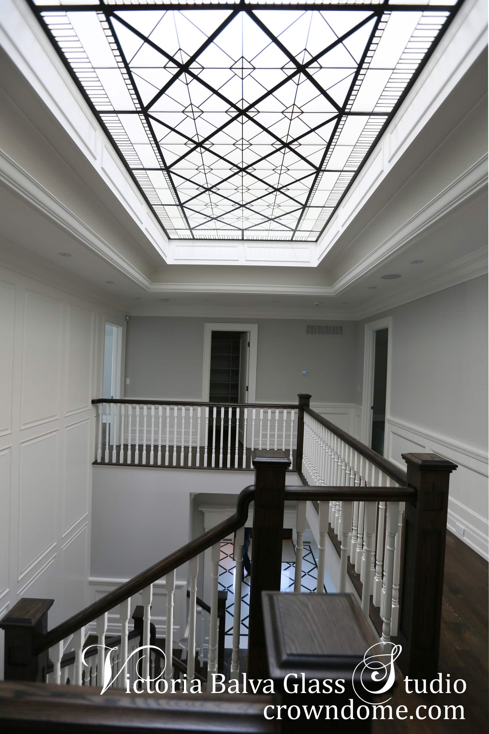 Large leaded glass skylight ceiling with clear beveled glass Cricket Club for a custom built house in traditional style. Second floor stairwell view