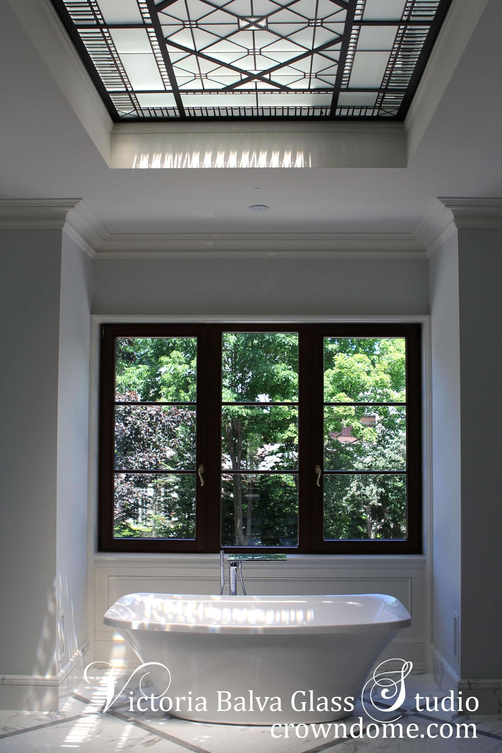 Bathroom interior with leaded glass skylight ceiling Leaded glass skylight design inspired bythe historical leaded glass skylights of Great BritainCastles.Clear textured glass, beveled glass, simple geometrical design. Leaded glass skylight design by stained glass artist Victoria Balva
