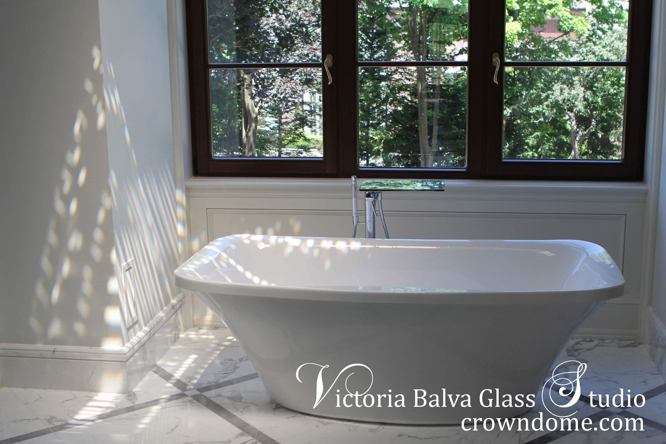 Bathroom interior design with reflections of small leaded glass skylight ceiling on a bathtub