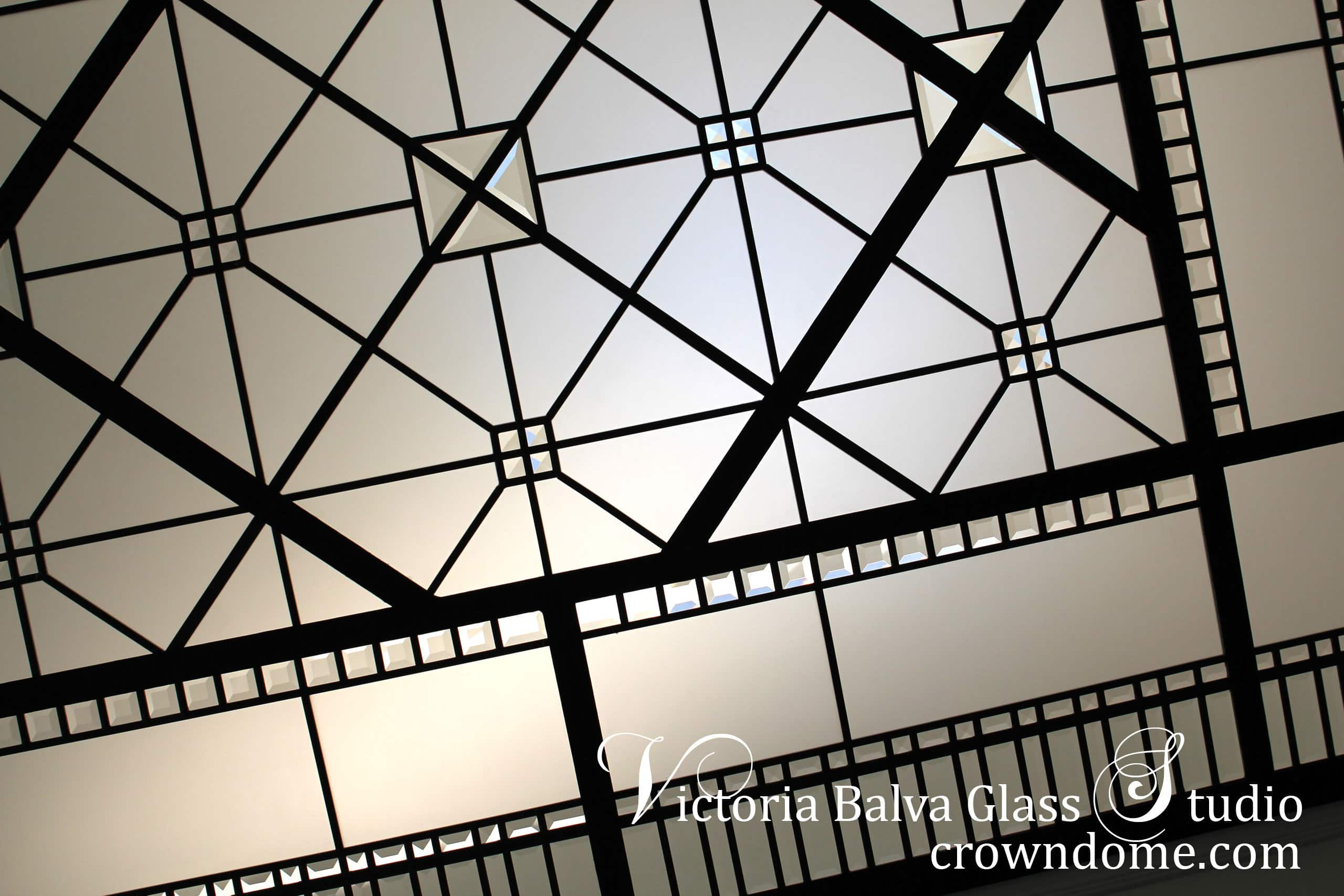 Simple geometrical leaded glass skylight ceiling for a bathroom of a luxury custom-built residence in Toronto. Leaded glass skylight design inspired bythe historical leaded glass skylights of Great BritainCastles.Clear textured glass, beveled glass, simple geometrical design. Leaded glass skylight design by stained glass artist Victoria Balva