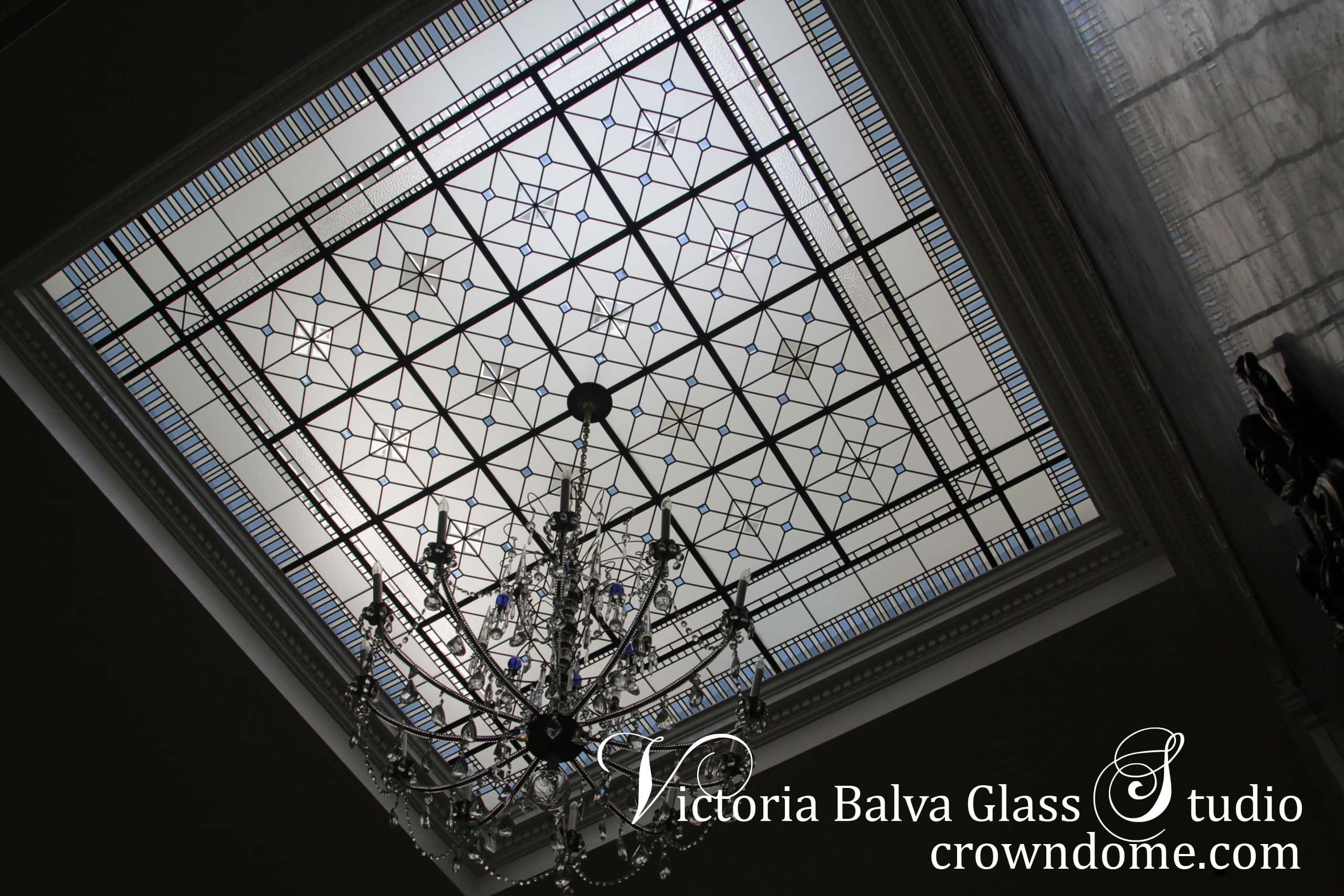 Colored beveled stained leaded glass square skylight ceiling with a crystal pendants chandelier hanging from the centre for a hallway of luxury custom built house. Pale blue beveled glass in combination with dark blue crystal pendants. Original design by architectural glass artist Victoria Balva