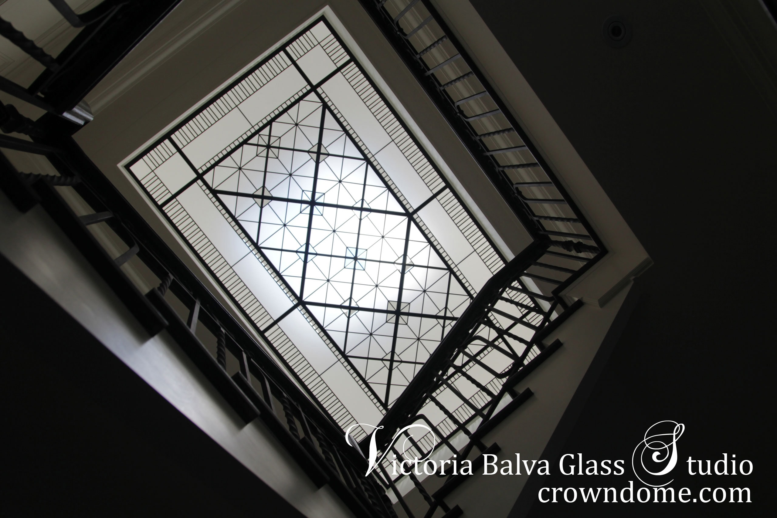 Large geometric leaded glass skylight ceiling York Mills in simple geometric style with clear textured glass and clear beveled glass for a stairwell of custom built residence in Toronto. Original design by glass artist Victoria Balva