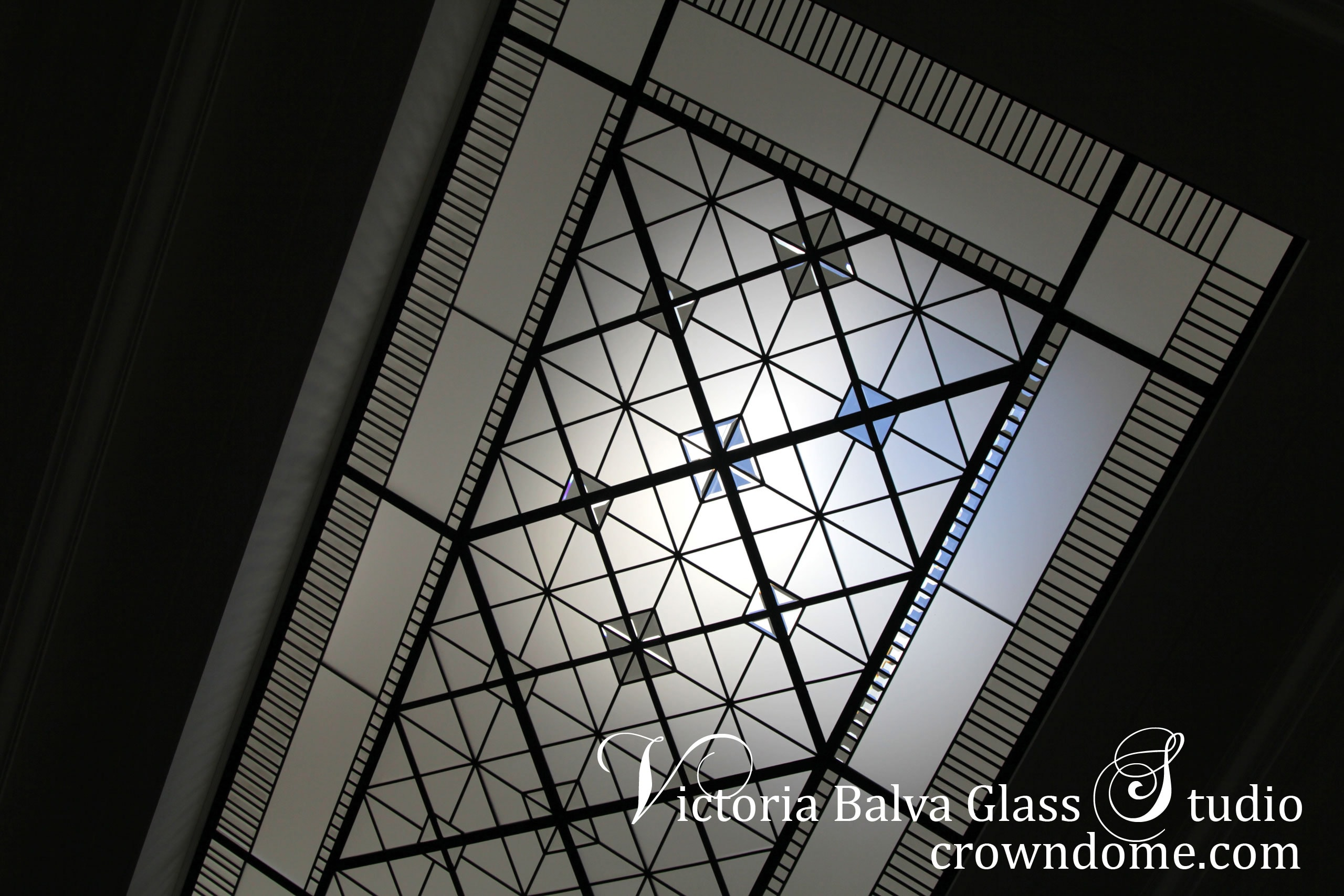 Beautiful colorless leaded glass skylight ceiling in geometric style with clear textured glass and clear beveled glass for a stairwell of custom built residence in Toronto. Original design by glass artist Victoria Balva