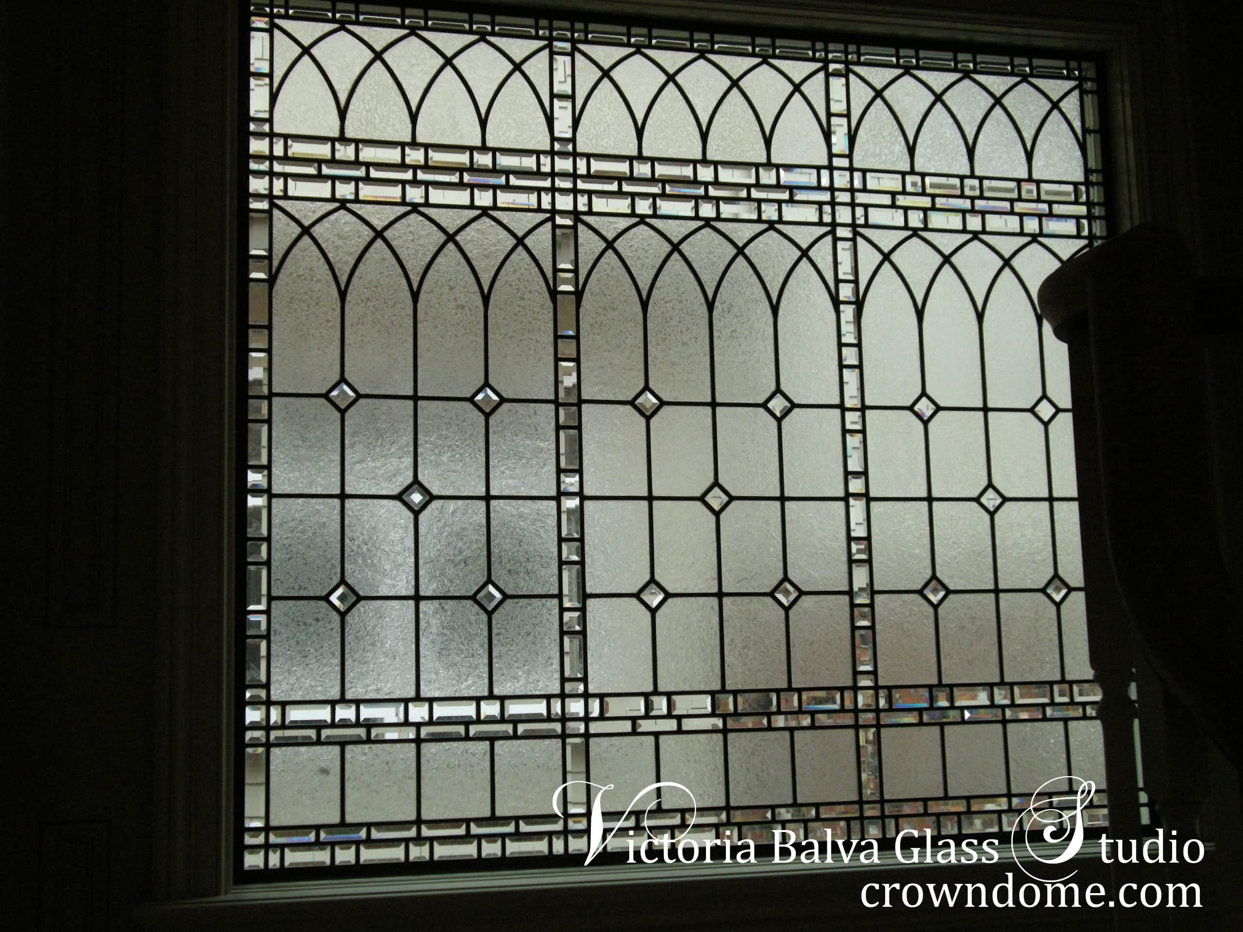 Large leaded glass window for stair-landing of a custom built residence in Toronto. Simple clear classical leaded glass window design to match Georgian style of the house. Leaded glass window design by glass artist Victoria Balva