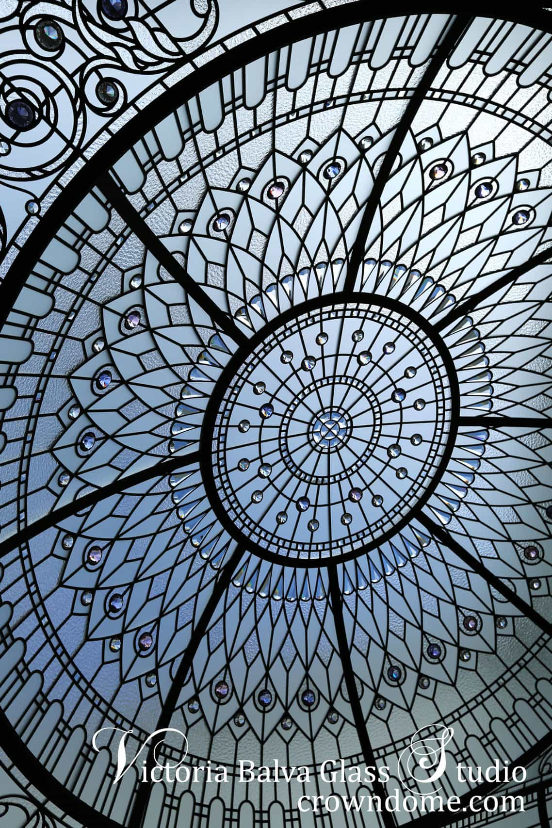 Ornamental stained glass dome detail with custom bevelled glass and crystal jewels