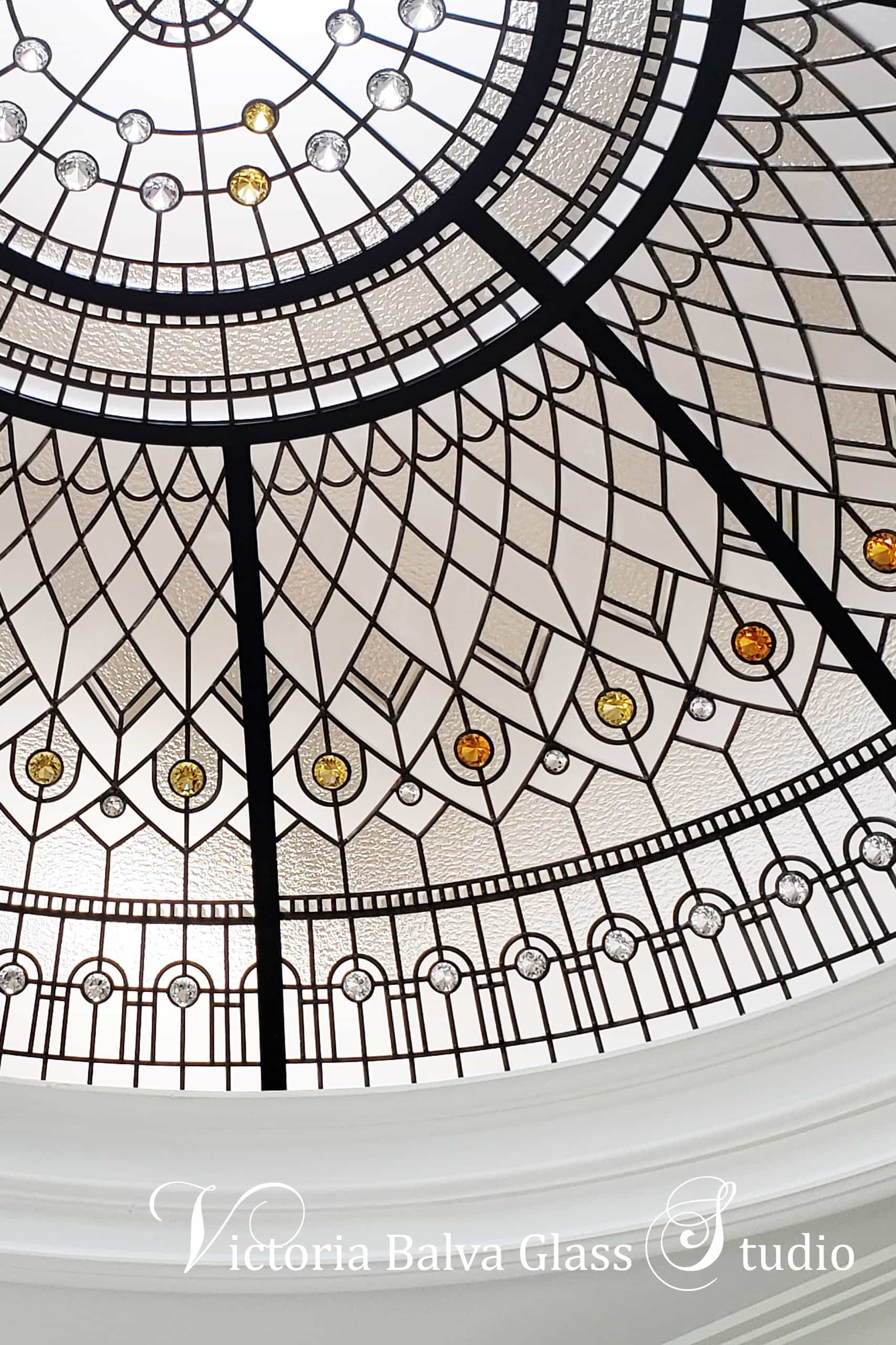 The beautiful stained glass dome classically inspired for a hallway of luxury built custom residence in Brampton with clear pale amber and yellow jewels