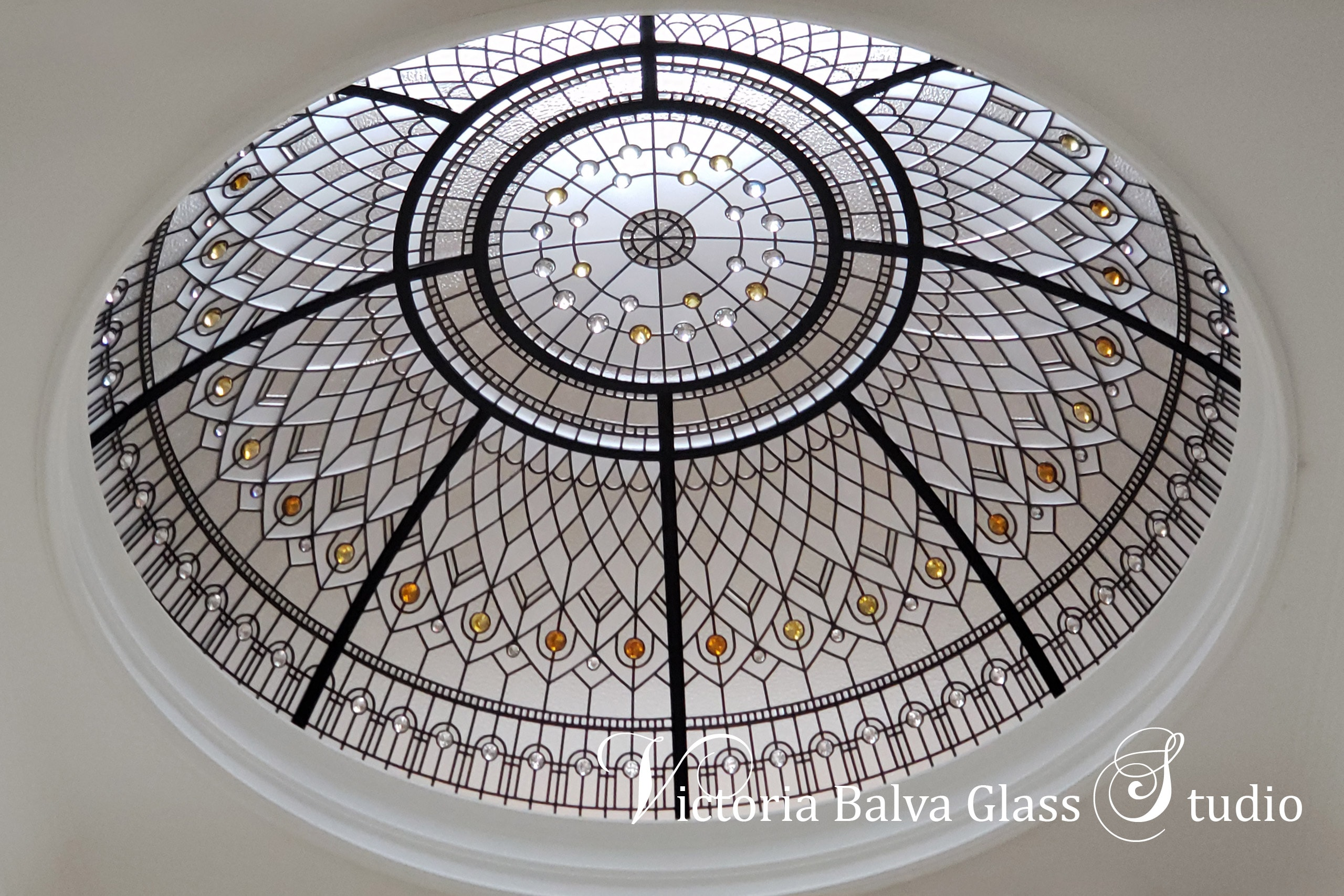 Large glass dome ceiling for the grand entryway of a custom built residence in Brampton with clear textured and bevelled glass. Pale yellow and amber crystal jewels accents