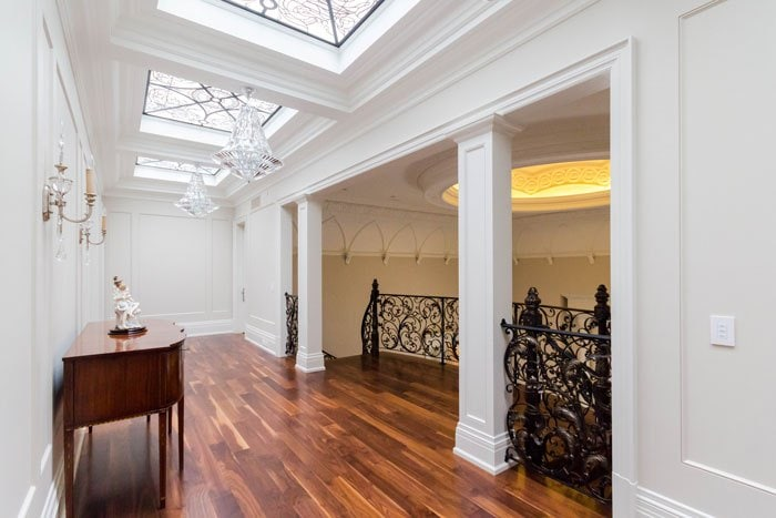 Upper hallway filled with light from stained and leaded glass skylights