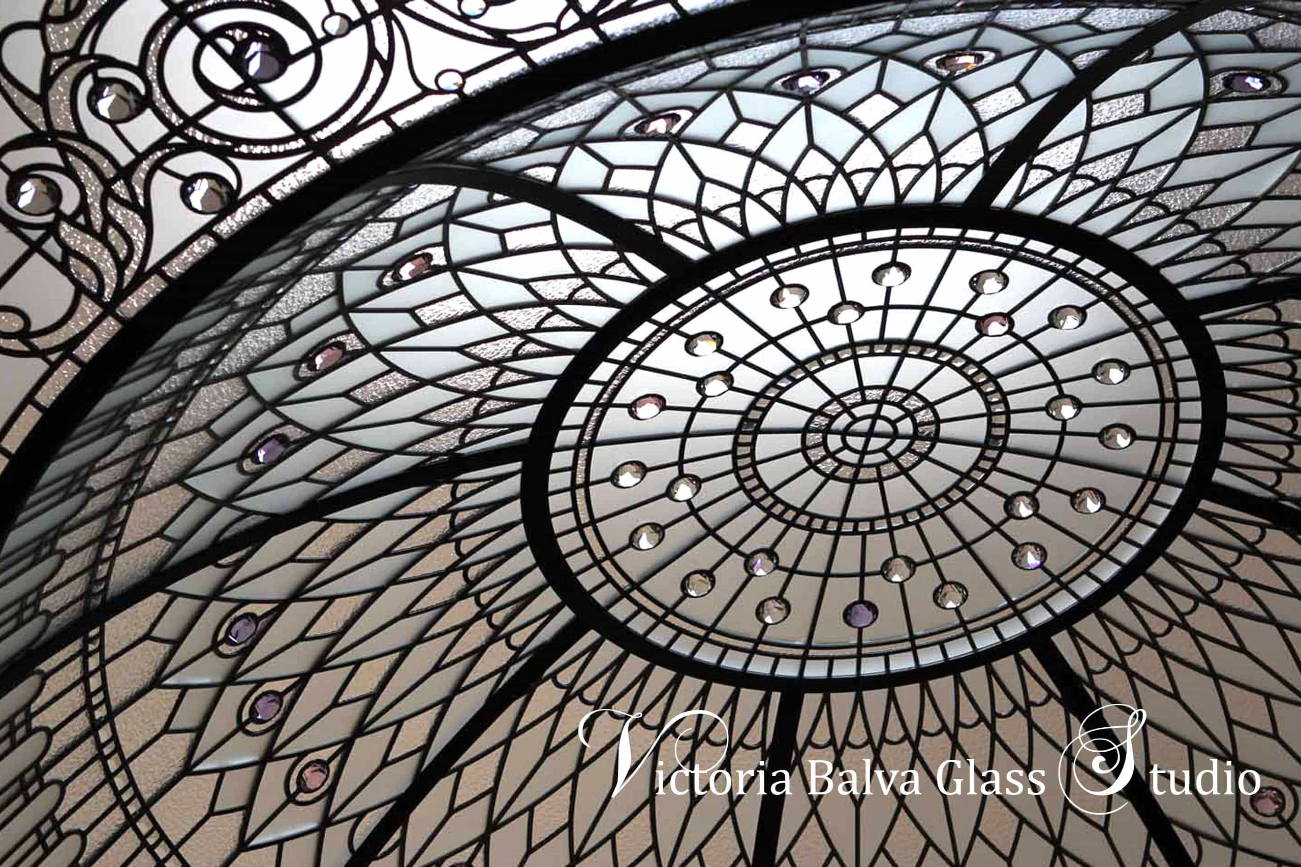 Large custom designed stained leaded glass dome with crystal jewels and custom beveled glass inspired by Hotel Plaza New York stained glass dome design. Clear textured glass, classic acanthus, stained glass dome ceiling custom designed and installed by glass artist Victoria Balva