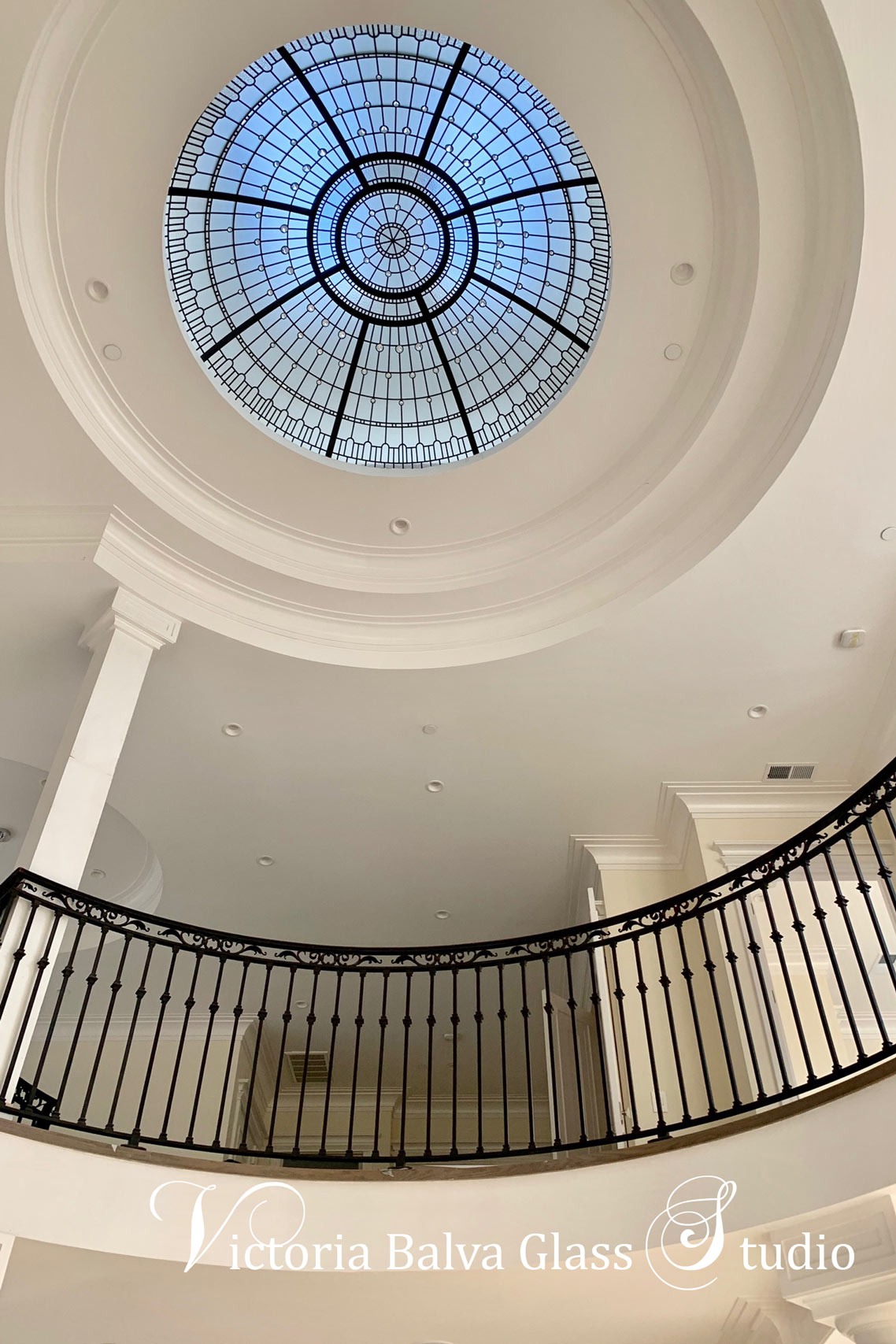Stained leaded glass dome created for a double height entrance of custom built residence in Los Angeles. Simple geometrical glass design with accent crystal jewels.