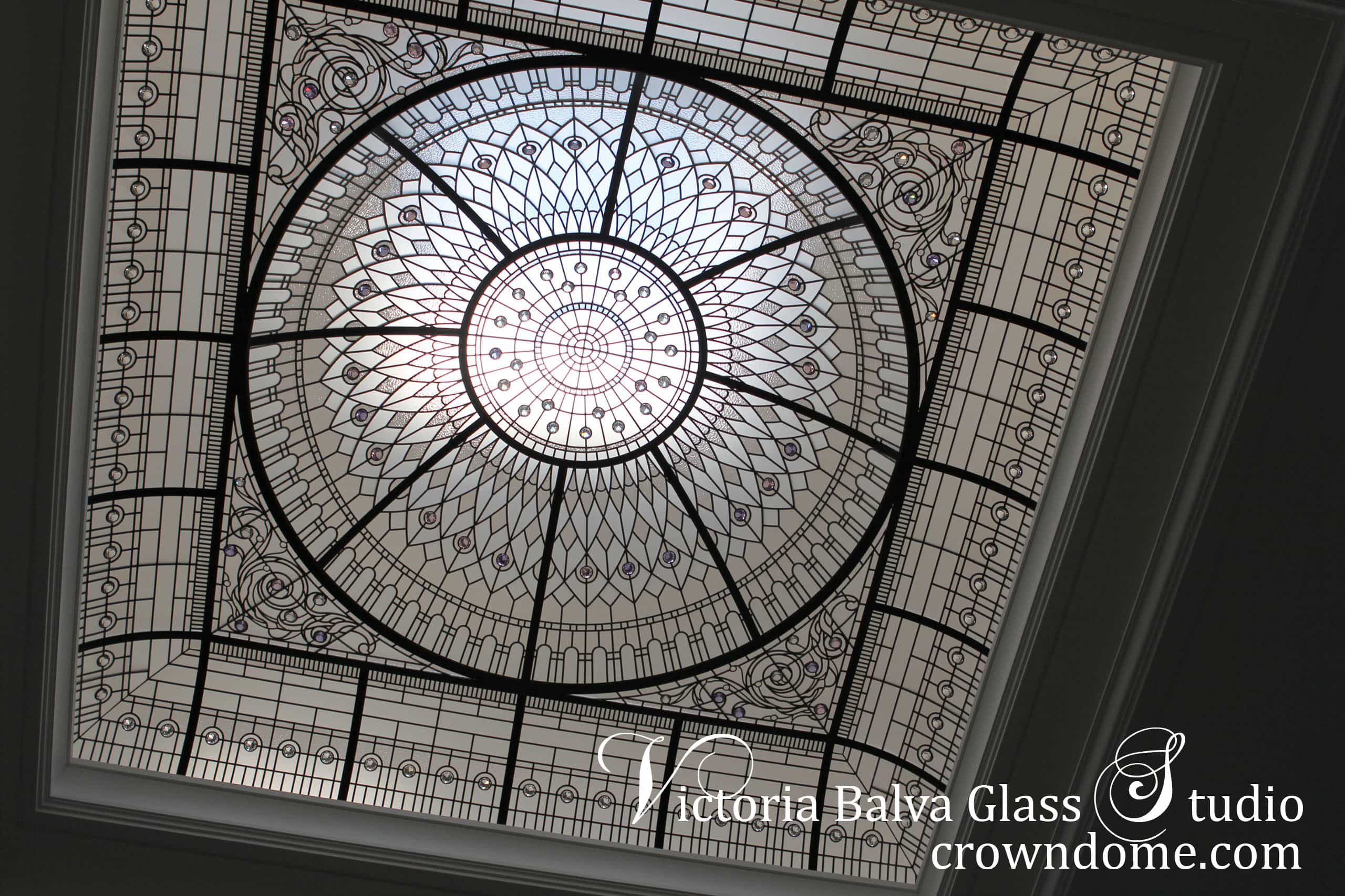 Custom large stained leaded glass dome artistic skylight for the interior design of a custom-built luxury residential home inspired by Hotel Plaza New York. Designed - built -Toronto. Artistic glass domed skylight design with custom beveled glass, crystal diamond jewels, and clear architectural textured glass. Impressive glass dome design