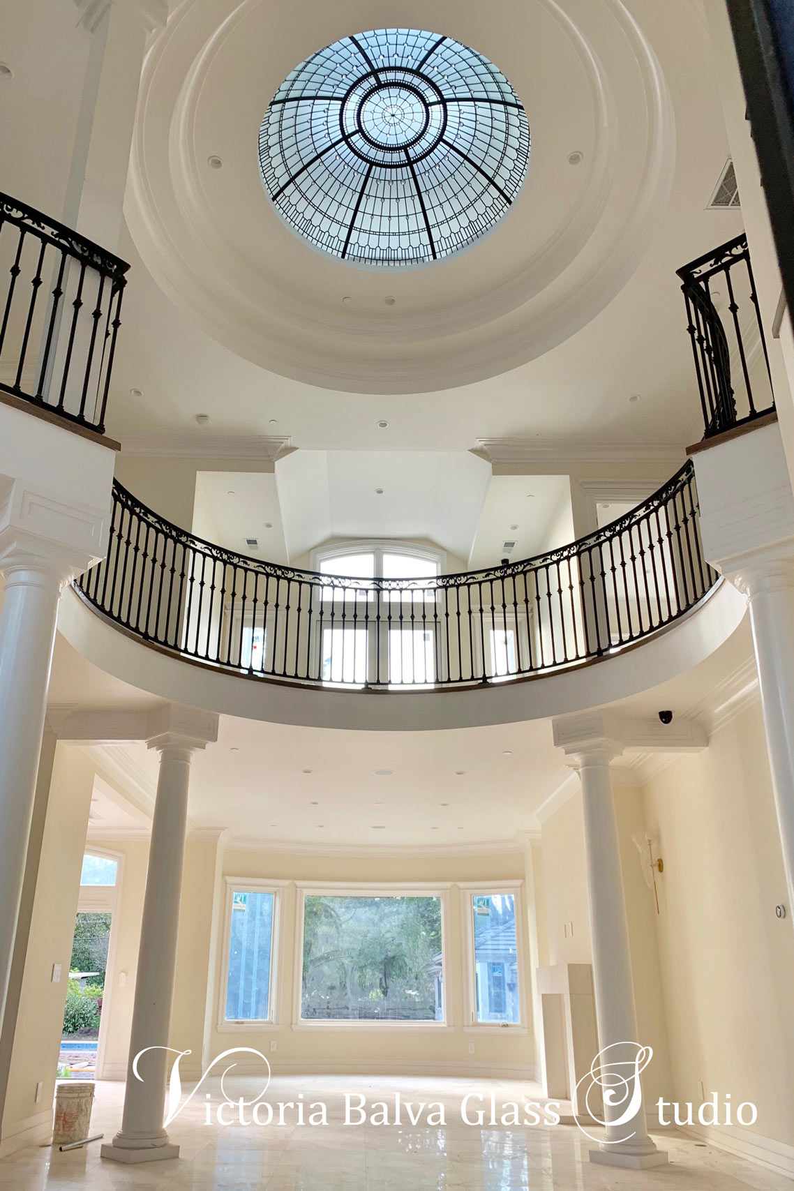 Custom stained leaded glass dome created for a double height foyer of luxury custom built residence in Los Angeles. Simple geometrical glass design with accent crystal jewels.