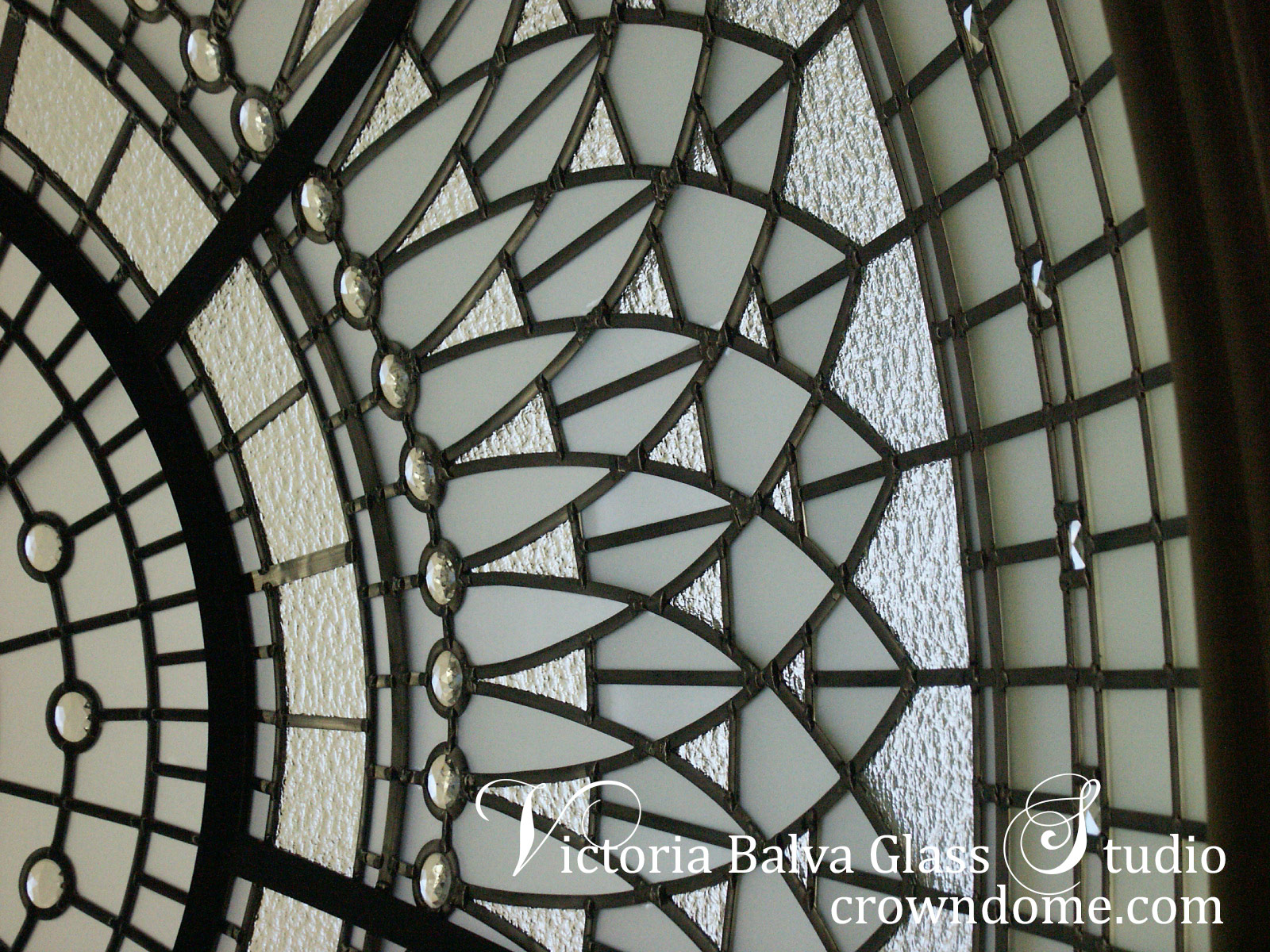 Beautiful stained leaded glass dome ceiling Irene custom designed and manufactured for a foyer of a custom built residence in Richmond Hill. Clear textured glassed in combination with accent jewels and beveled glass were used to enrich the appearance of the stained leaded glass dome skylight