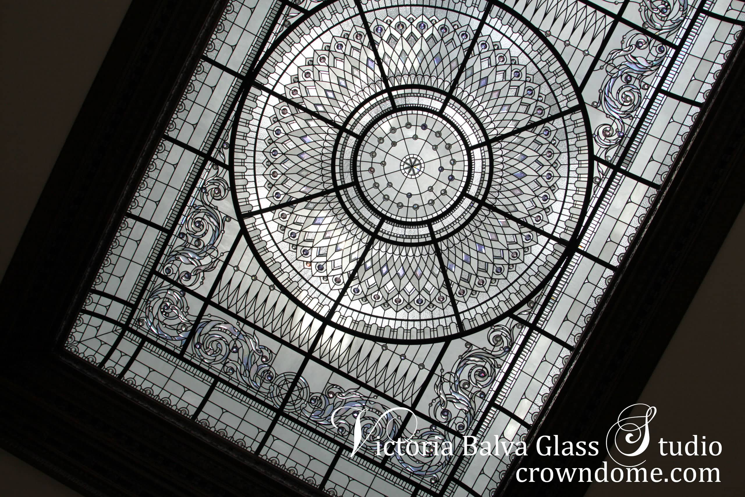 Large stained leaded glass domed ceiling skylight residential home w intricate glass dome classic design installed in New York. Large stained glass dome skylights with clear textured glasses elusive colors custom beveled glass accent crystal jewels for the interior entrance hall of luxury custom built house. Stained glass dome lay light design by glass artist Victoria Balva