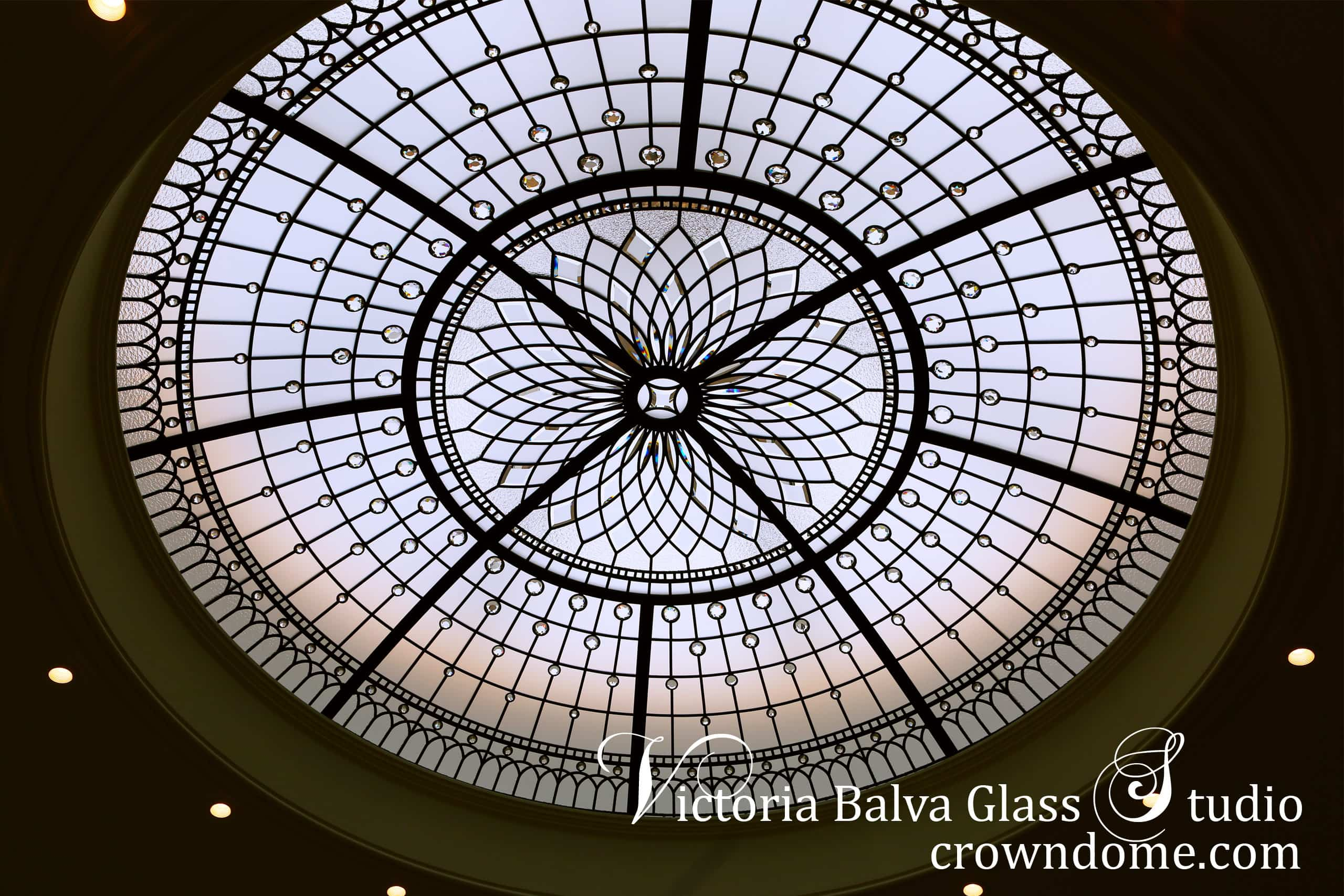 Stained leaded glass dome with crystal jewels and custom bevelled glass to cover roof skylight