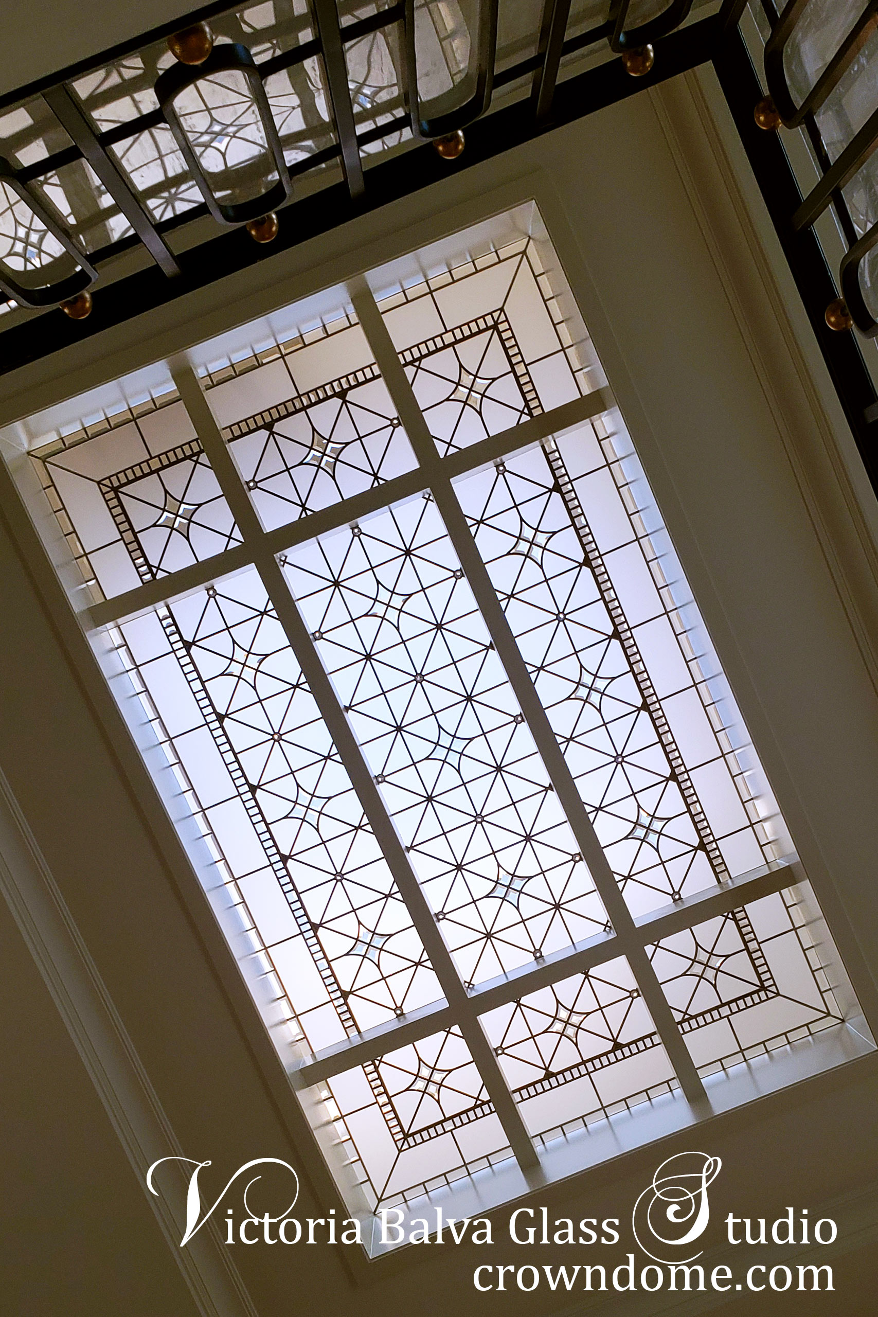 Leaded glass ceiling lens with acid etched glass and custom hand bevelled glass designed and fabricated for a luxury custom built real estate in Thornhill, ON.