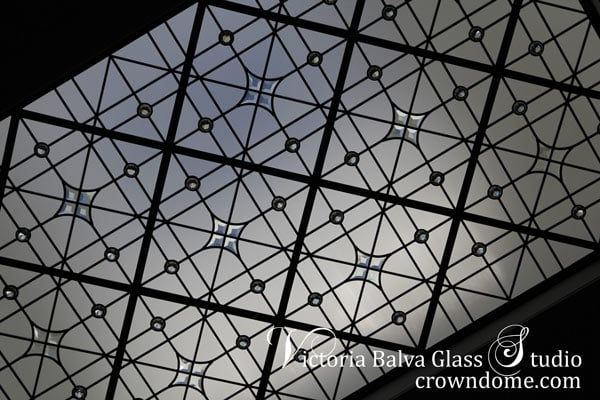 Contemporary stained leaded glass skylight ceiling with custom hand bevelled glass and crystal clear jewels in geometrical style