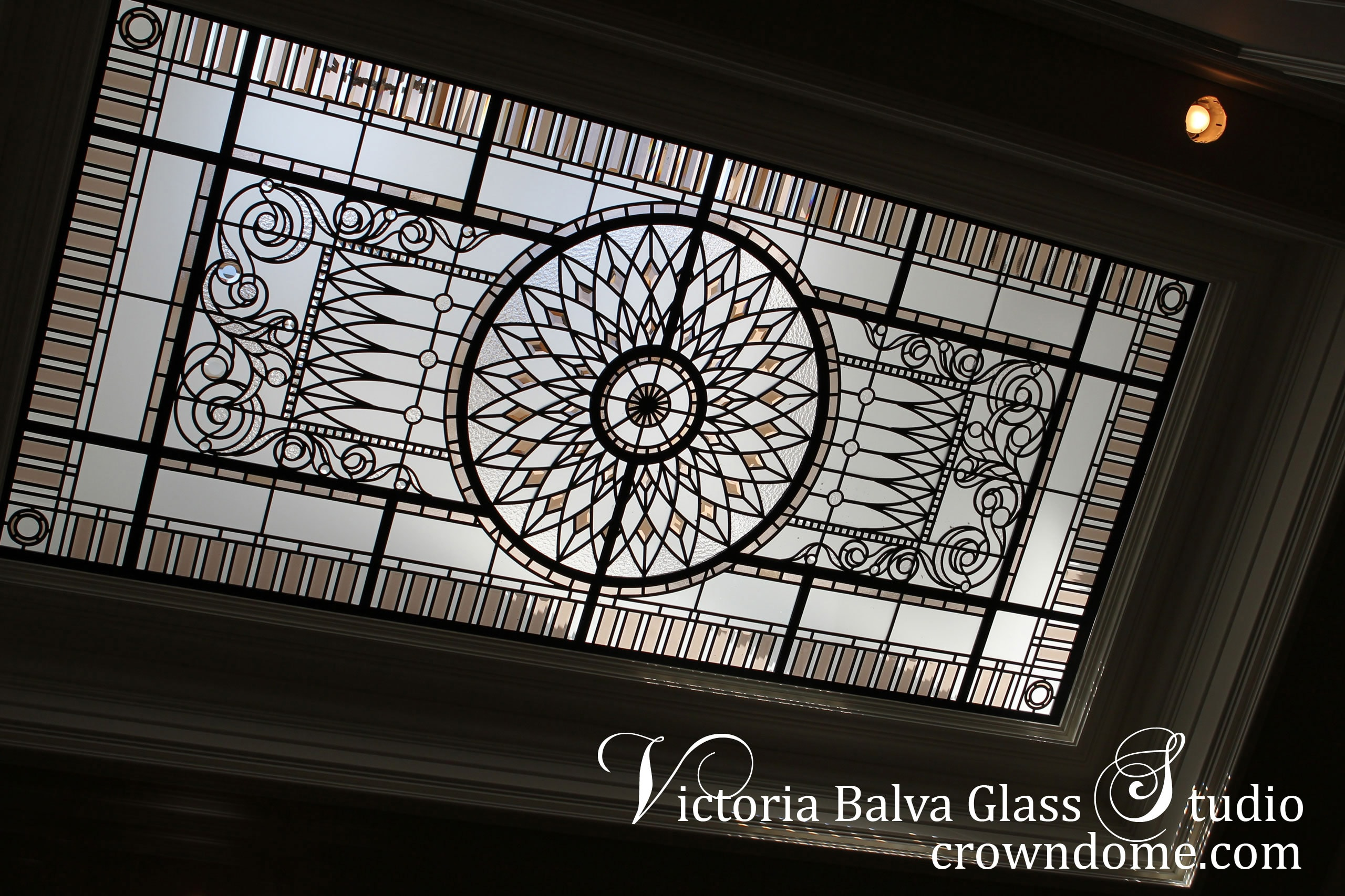 Luxury stained leaded glass skylight ceiling Marion with pale colored beveled glass, acanthus ornamental border, clear textured glass for a stairwell of a custom built residence on Mississauga Rd. Luxury style is reflected in stained leaded glass skylight design