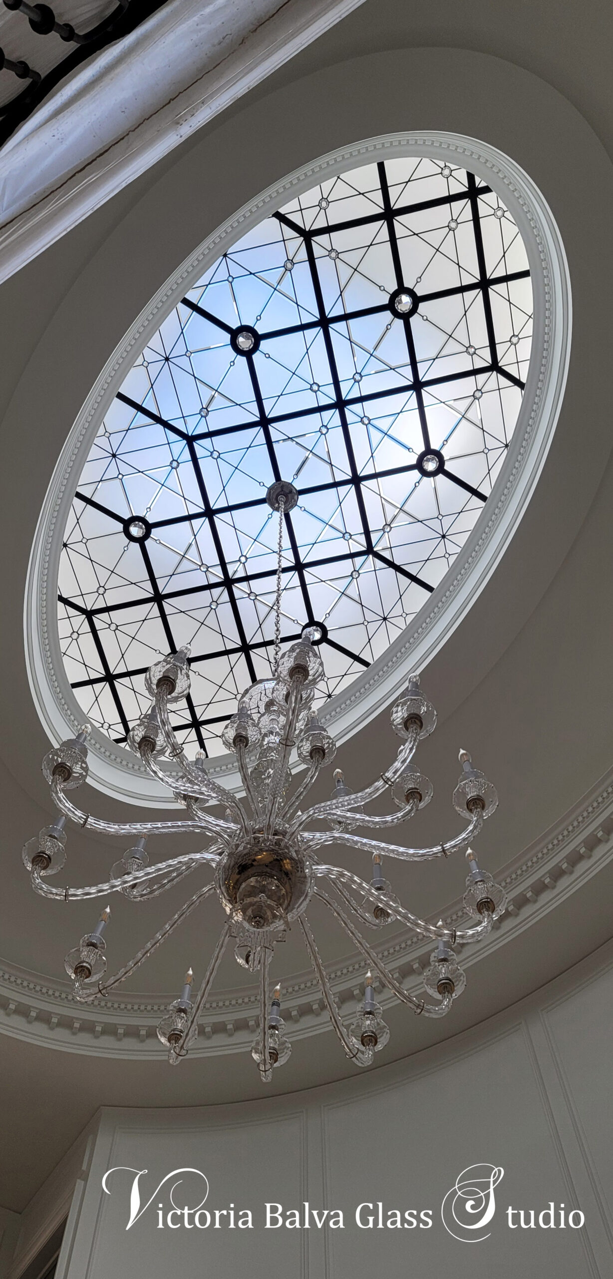 Modern oval stained glass ceiling for the custom built residence in Toronto