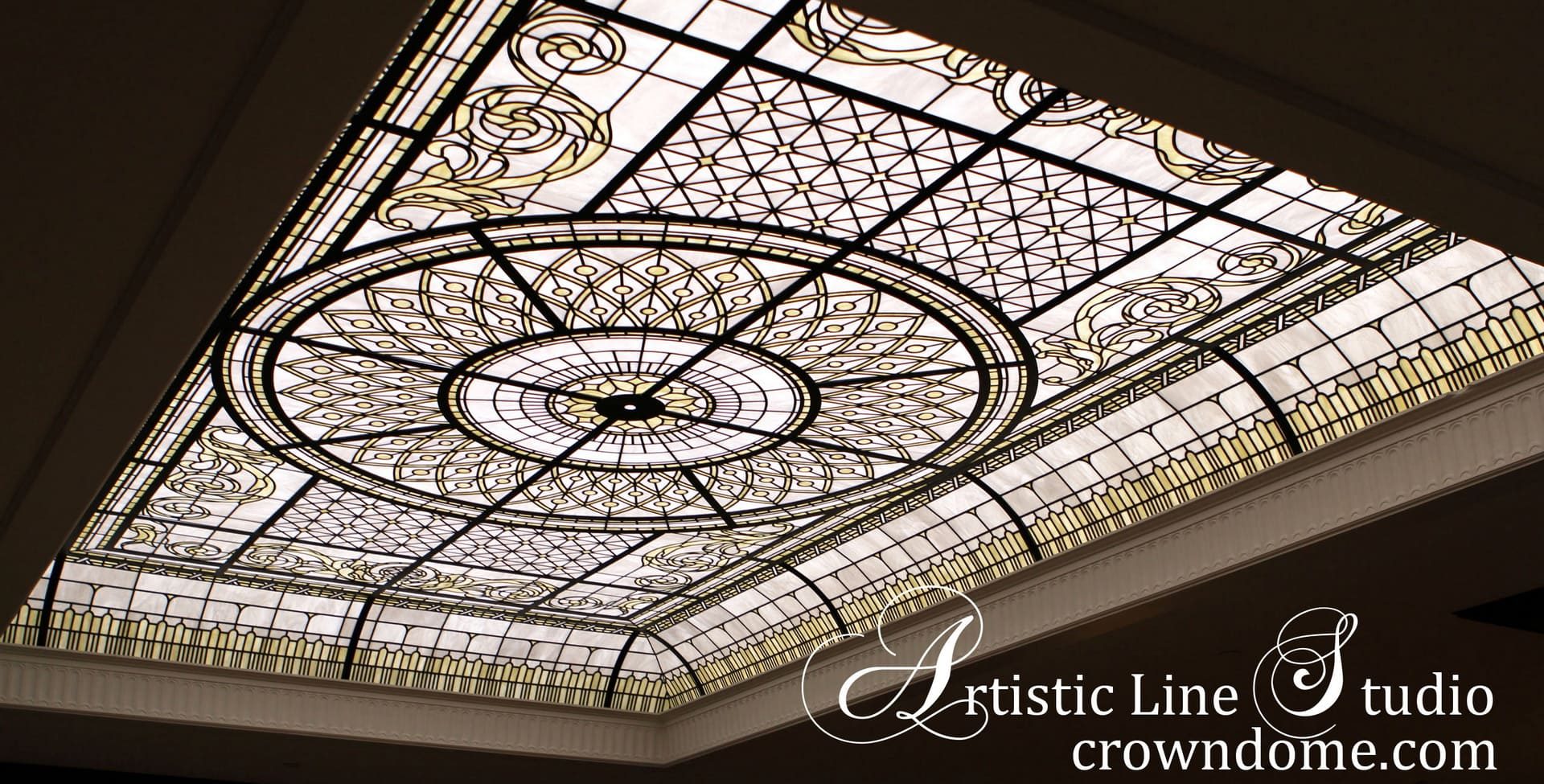 Stained leaded glass skylight ceiling in pale-ivory and white opal glass with a chandelier for a custom-built luxury estate in New York. Stylish grand entrance foyer design ideas. Classically inspired glass design for the front entrance