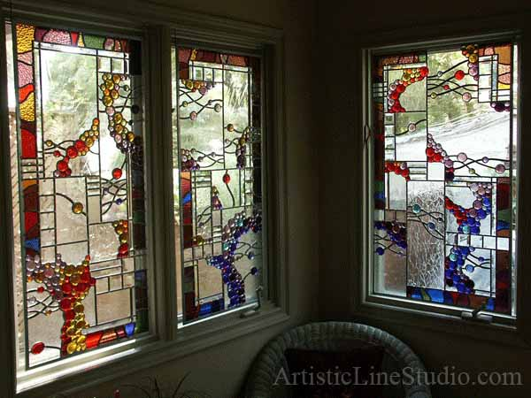 Contemporary stained glass windows in abstract style with colored globes and mouth blown clear antique glass for the interior of the house in Toronto